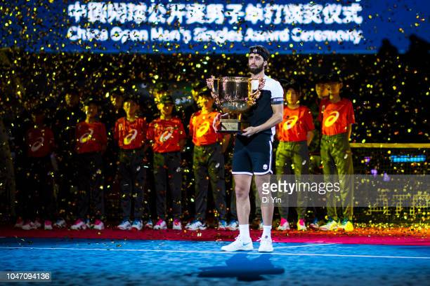 Nikoloz Basilashvili of Georgia hold the winner's trophy after winning his Men's Singles Finals match against Juan Martin Del Potro of Argentina in...