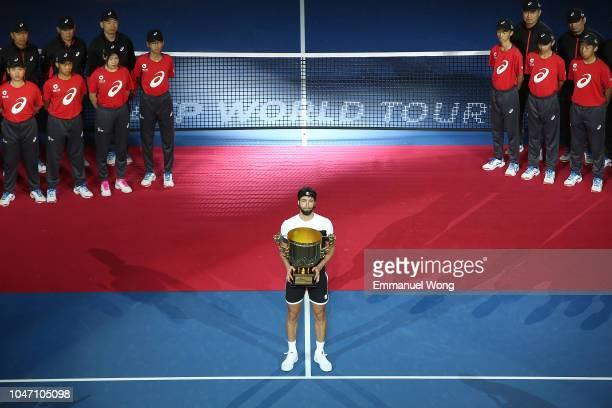 Nikoloz Basilashvili of Georgia hold the winner's trophy after winning his Men's Singles Finals match against Juan Martin Del Potro of Argentina on...