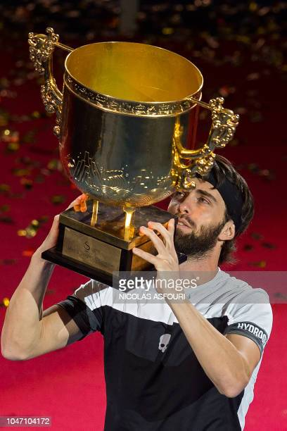 Nikoloz Basilashvili of Georgia holds the trophy after winning the men's final match against Juan Martin Del Potro of Argentina at the China Open...