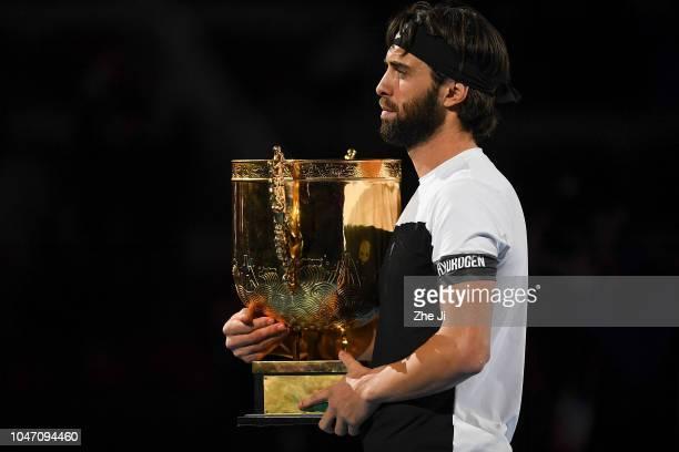Nikoloz Basilashvili of Georgia holds the winner's trophy after winning the Men's Singles final against Juan Martin Del Potro of Argentina on day 9...