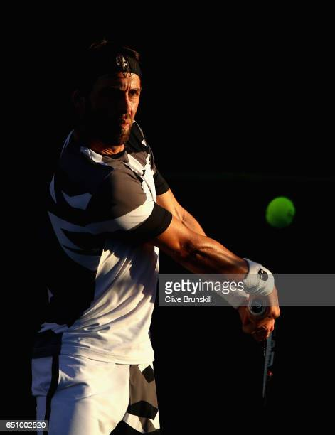 Nikoloz Basilashvili of Georgia plays a backhand against Darian King of Barbados in their first round match during day four of the BNP Paribas Open...