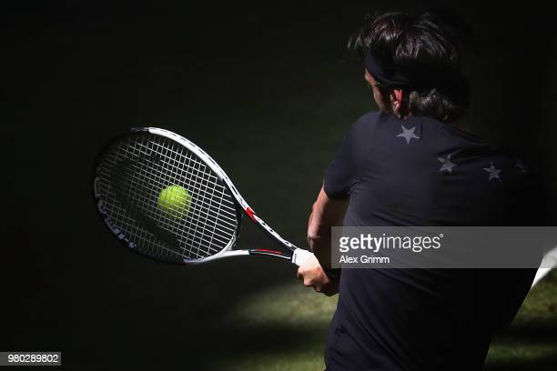 Nikoloz Basilashvili of Georgia plays a backhand to Borna Coric of Croatia during their round of 16 match on during day 4 of the Gerry Weber Open at...