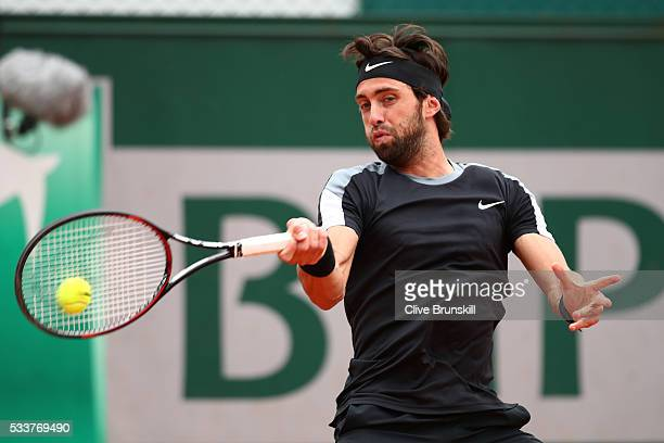 Nikoloz Basilashvili of Georgia plays a forehand during the Men's Singles first round match against Kyle Edmund of Great Britain on day two of the...