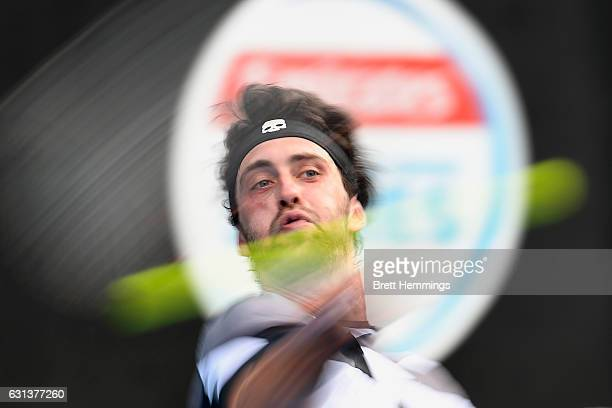 Nikoloz Basilashvili of Georgia plays a forehand shot in his first round match against Jordan Thompson of Australia during day three of the 2017...