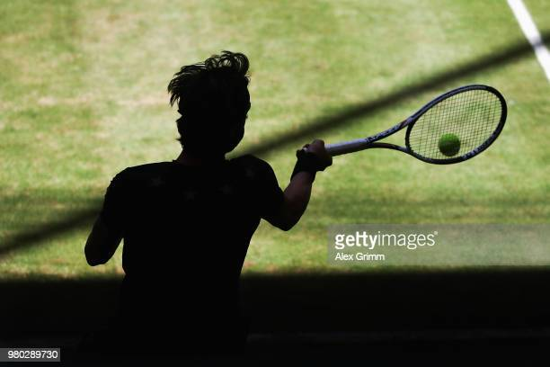 Nikoloz Basilashvili of Georgia plays a forehand to Borna Coric of Croatia during their round of 16 match on during day 4 of the Gerry Weber Open at...