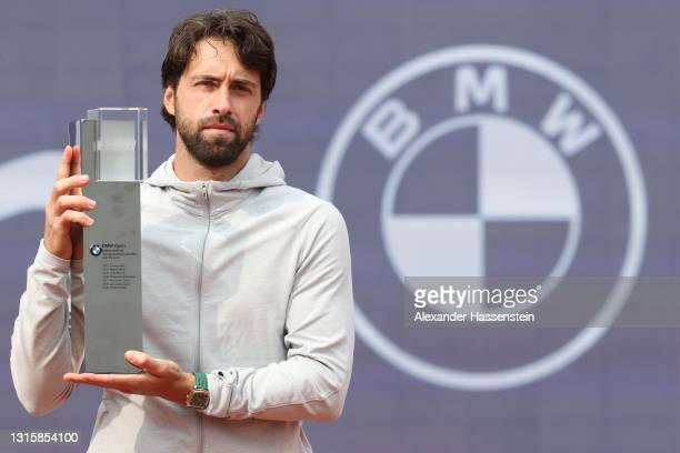 Nikoloz Basilashvili of Georgia poses with his winner trophy after winning his finale match against Jan-Lennard Struff of Germany on day 9 of the BMW...
