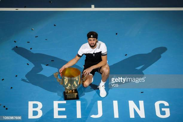 Nikoloz Basilashvili of Georgia poses with the trophy after winning the Men's Singles final match against Juan Martin del Potro of Argentina on day...