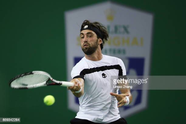Nikoloz Basilashvili of Georgia returns a shot against during the Men's singles mach against Juan Martin del Potro of Argentina on day two of...