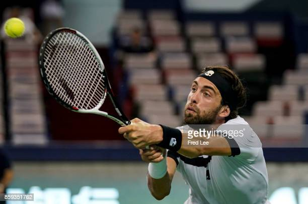 Nikoloz Basilashvili of Georgia returns a shot against Juan Martin del Potro of Argentina during the First Round on Day 2 of 2017 ATP 1000 Shanghai...