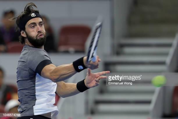 Nikoloz Basilashvili of Georgia returns a shot against Kyle Edmund of Great Britain during the Men's Single Semifinal Match on day 8 of 2018 China...
