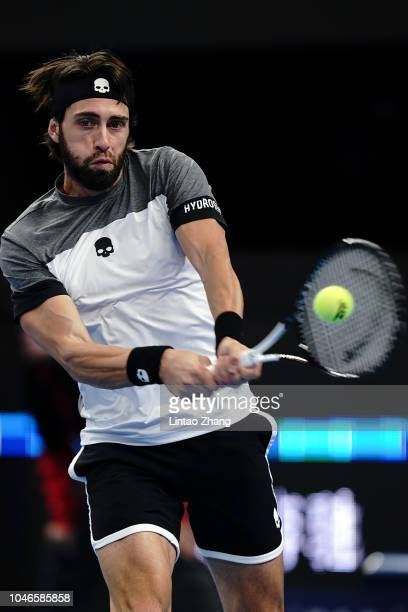 Nikoloz Basilashvili of Georgia returns a shot against Kyle Edmund of Great Britain during his Men's Singles Semifinals match in the 2018 China Open...