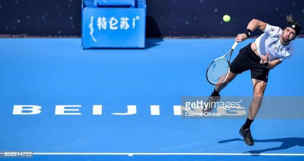 Nikoloz Basilashvili of Georgia returns a shot against Nick Kyrgios of Australia during the men's singles first round on day four of 2017 China Open...