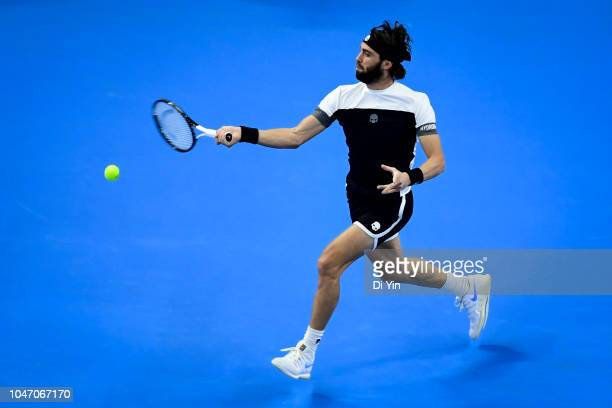 Nikoloz Basilashvili of Georgia returns the ball against Juan Martin Del Potro of Argentina during his Men's Singles Finals match in the 2018 China...