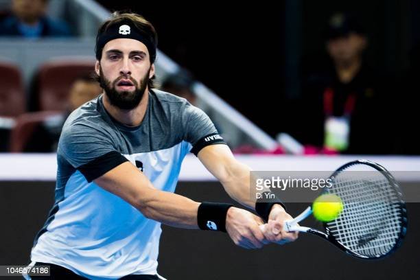 Nikoloz Basilashvili of Georgia returns the ball against Kyle Edmund of Great Britain during his Men's Singles Semifinals match in the 2018 China...