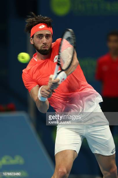Nikoloz Basilashvili of Georgia returns the ball to Novak Djokovic of Serbia during their ATP Qatar Open tennis quarterfinal in Doha on January 3 2019
