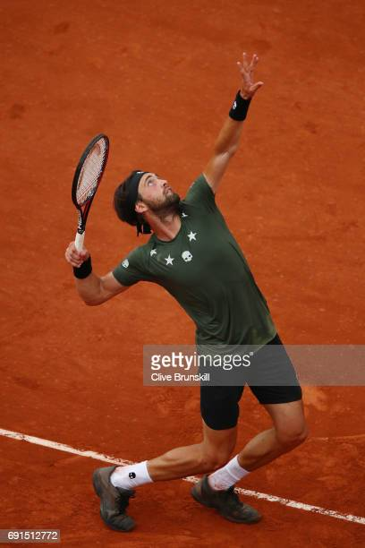 Nikoloz Basilashvili of Georgia serves during the men's singles third round match against Rafael Nadal of Spain on day six of the 2017 French Open at...