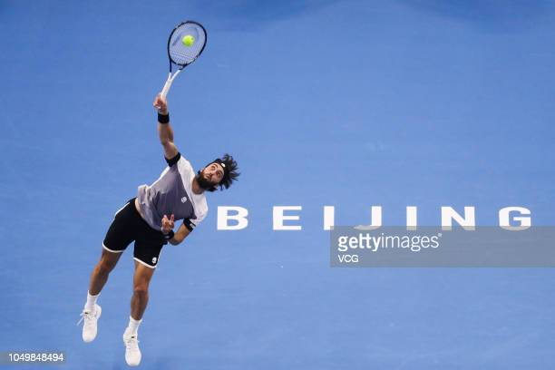Nikoloz Basilashvili of Georgia serves in the Men's Singles Quarterfinal match against Malek Jaziri of Tunisia on day seven of the 2018 China Open at...