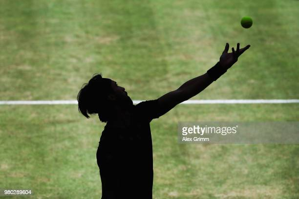 Nikoloz Basilashvili of Georgia serves the ball to Borna Coric of Croatia during their round of 16 match on during day 4 of the Gerry Weber Open at...