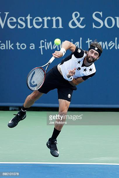 Nikoloz Basilashvili of Georgia serves to David Goffin of Belgium during the first round of play on Day 4 of the Western Southern Open at the Lindner...