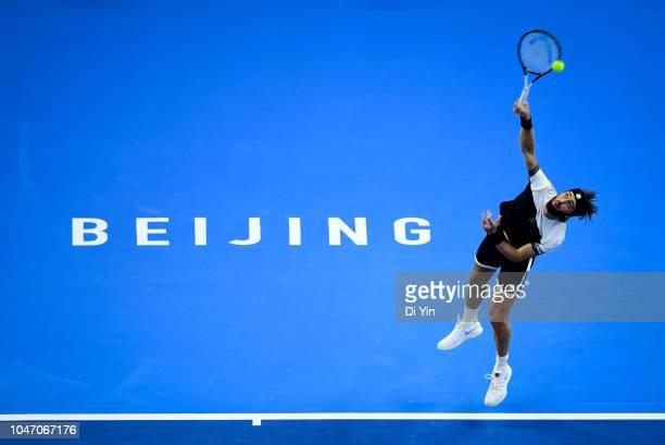 Nikoloz Basilashvili of Georgia serves to Juan Martin Del Potro of Argentina during his Men's Singles Finals match in the 2018 China Open at the...