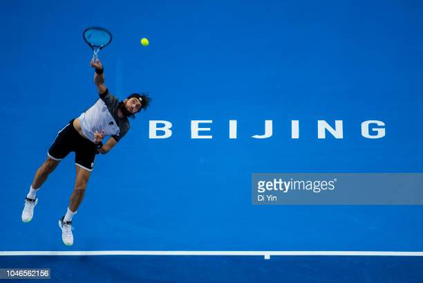Nikoloz Basilashvili of Georgia serves to Kyle Edmund of Great Britain during his Men's Singles Semifinals match in the 2018 China Open at the China...