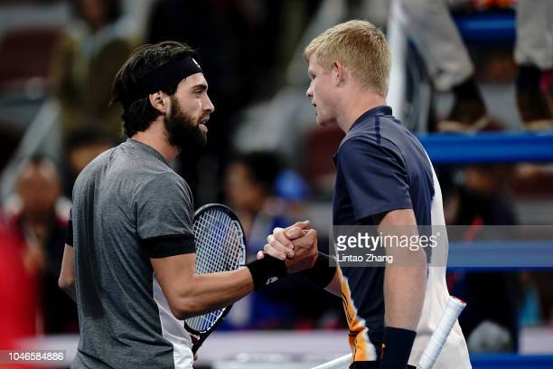 Nikoloz Basilashvili of Georgia shakes hands with Kyle Edmund of Great Britain after during his Men's Singles Semifinals match in the 2018 China Open...