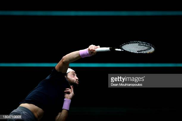 Nikoloz Basilashvili of Georgian serves in his match against Cameron Norrie of Great Britain during Day 1 of the 48th ABN AMRO World Tennis...