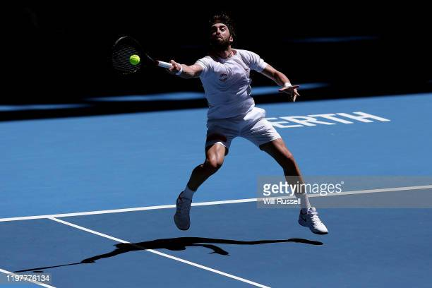 Nikoloz Basilashvili of Team Georgia plays a forehand to Yoshihito Nishioka of Team Japan during day four of the 2019 ATP Cup Group Stage at RAC...