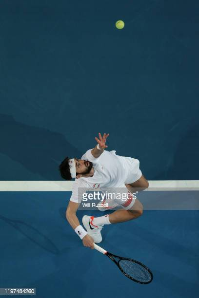 Nikoloz Basilashvili of Team Georgia serves to Rafael Nadal of Team Spain during day two of the 2020 ATP Cup Group Stage at RAC Arena on January 04...