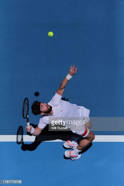 Nikoloz Basilashvili of Team Georgia serves to Yoshihito Nishioka of Team Japan during day four of the 2019 ATP Cup Group Stage at RAC Arena on...