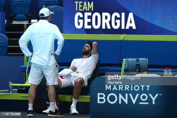 Nikoloz Basilashvili of Team Georgia sits on the team bench after being defeated by Yoshihito Nishioka of Team Japan during day four of the 2019 ATP...