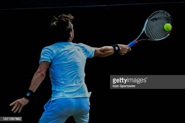 Nikoloz Basilashvili reaches back for a volley against Matteo Berrettini during the WinstonSalem Open on August 21 2018 at the Wake Forest Tennis...