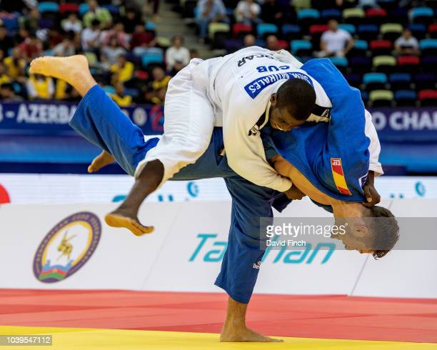 Nikoloz Sherazadishvili of Spain throws Ivan Felipe Silva Morales of Cuba for an ippon with an inner thigh throw to win the u90kg final and the gold...
