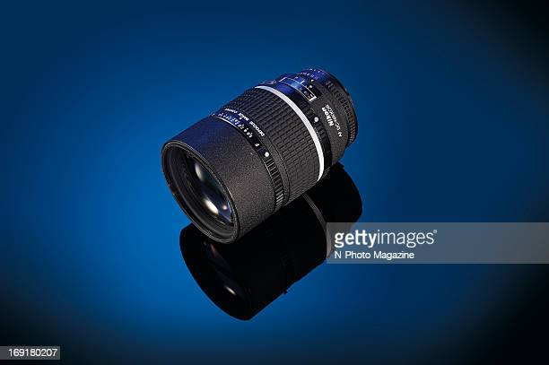 A Nikon 135mm f/2D AF DC telephoto lens photographed on a blue background taken on October 4 2012