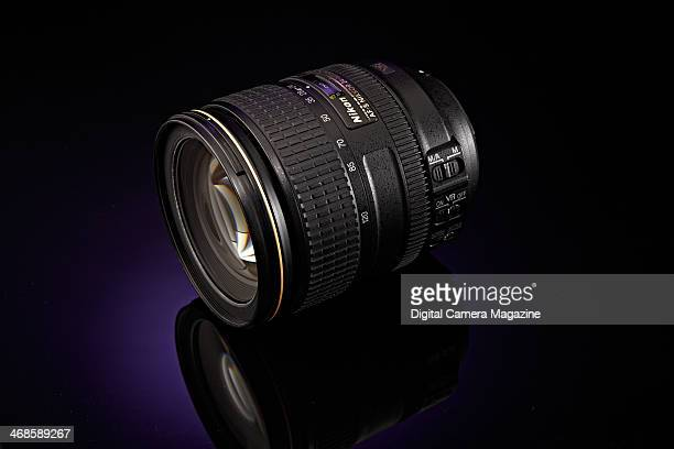 A Nikon AFS 24120mm f/4G ED VR fullframe SLR lens photographed on a purple background taken on May 22 2013