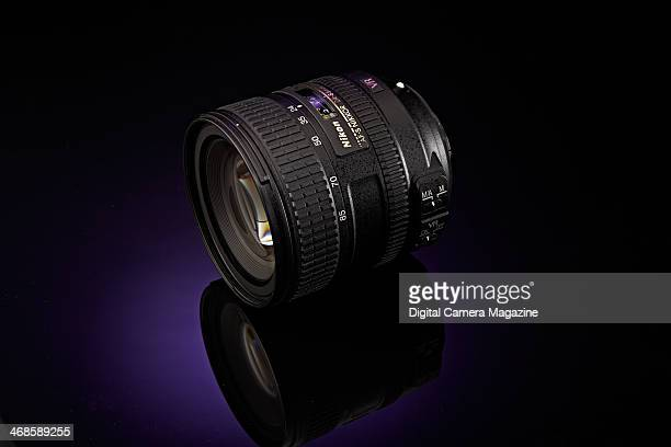 A Nikon AFS 2485mm f/3545G ED VR fullframe SLR lens photographed on a purple background taken on May 22 2013