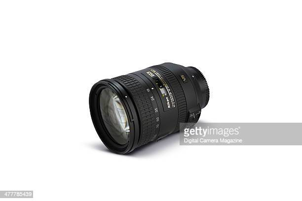 A Nikon AFS DX 18200mm f/3556G ED VR II camera lens photographed on a white background for a feature on travelfriendly superzoom lenses taken on June...
