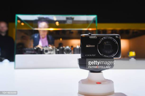 A Nikon camera is seen at the Nikon stand at the Photokina trade fair in Cologne western Germany on September 27 2018 The fair for the photographic...