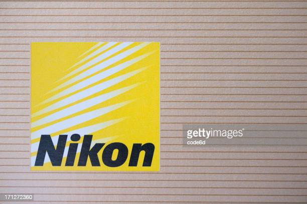 nikon corporation logo printed on camera packaging - nikon stock pictures, royalty-free photos & images