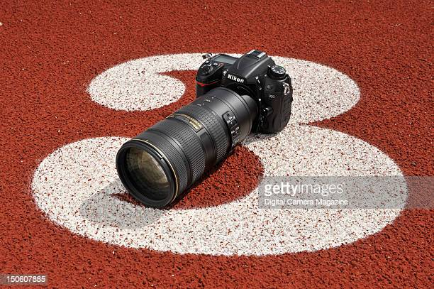 Nikon D7000 digital SLR camera with telephoto zoom lens During a shoot for Digital Camera Magazine August 15 2011