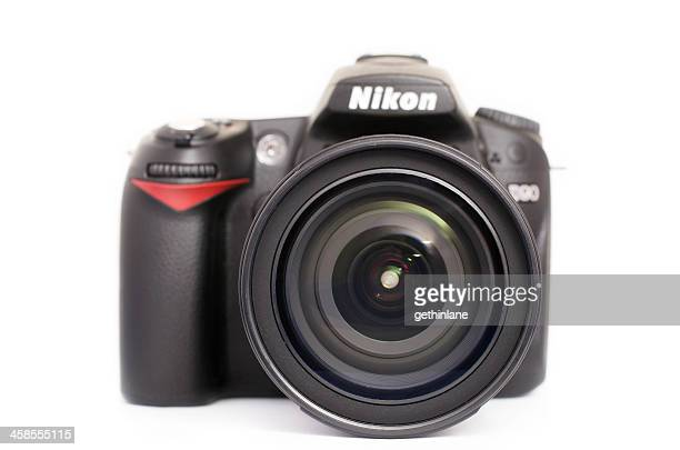 nikon digital slr with lens attached - nikon stock pictures, royalty-free photos & images