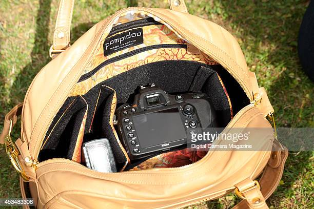 Nikon DSLR camera and flash inside a Pompidoo Palermo camera bag photographed during a shoot for Digital Camera Magazine July 12 2013