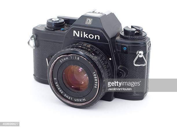 nikon em slr isolated on white - nikon stock pictures, royalty-free photos & images
