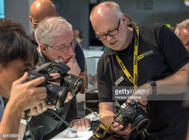 Nikon employee gives information to visitors at Nikon stand in Photokina 2014 in Cologne Germany 18 September 2014 Photokina the world's leading...