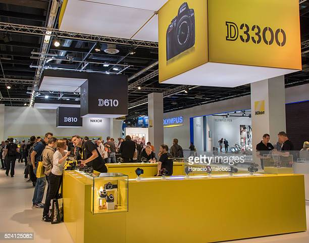 Nikon employees give information to visitors at Nikon stand in Photokina 2014 in Cologne Germany 18 September 2014 Photokina the world's leading...