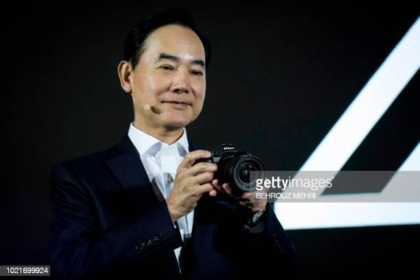 Nikon president Kazuo Ushida presents the new fullframe mirrorless Nikon Z7 camera during an event unveiling Nikon's new Z series cameras and Z mount...