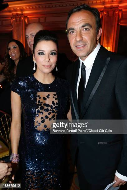Nikos Aliagas and Eva Longoria which presents 'Global Gift Gala' at Hotel George V on May 13, 2013 in Paris, France.