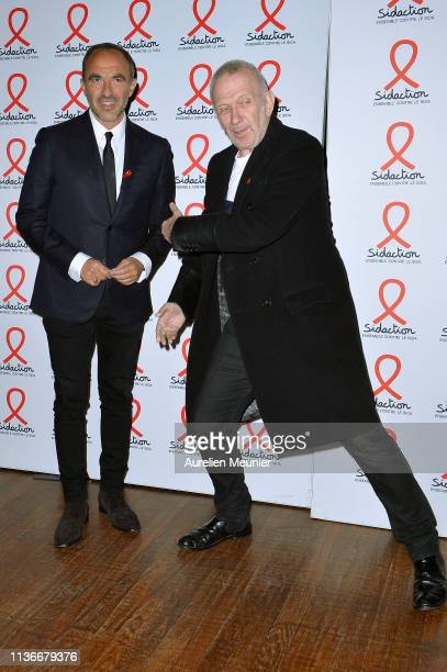 Nikos Aliagas and Jean Paul Gaultier attend the Sidaction 2019 photocall at Salle Wagram on March 18 2019 in Paris France