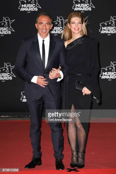 Nikos Aliagas and Tina Grigoriou arrive at the 19th NRJ Music Awards ceremony at the Palais des Festivals on November 4 2017 in Cannes France
