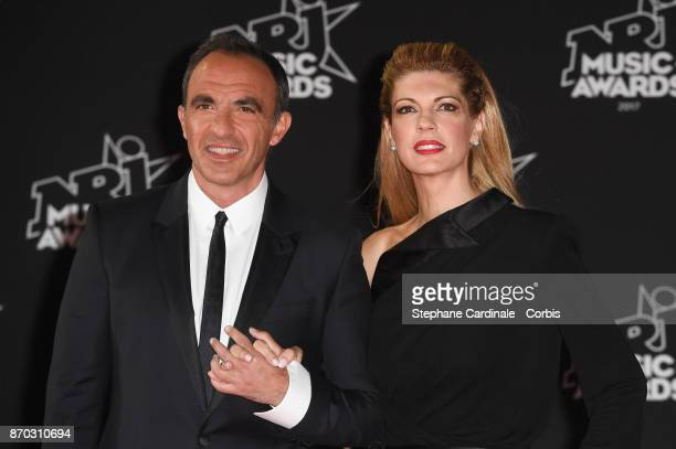 Nikos Aliagas and Tina Grigoriou attend the 19th NRJ Music Awards on November 4 2017 in Cannes France